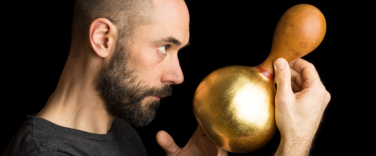 Portrait of Tobias Birgersson, holding gold plated gourd.